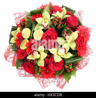 Floristic composition of red roses, red gerberas and orchids. Floral compositions, design a bouquet, floral arrangement. - Stock Photo