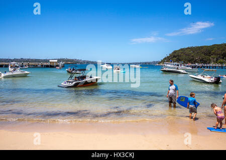 Father and young children in the water at Chowder Bay in Sydney,Australia - Stock Photo