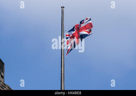 London, UK. 24th March, 2017. Union Jack flag at half mast on the Portcullis House after the terrorist attack. Credit: - Stock Photo