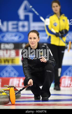 Beijing, China. 23rd Mar, 2017. Anna Sidorova of Russia competes during the World Women's Curling Championship semifinal - Stock Photo