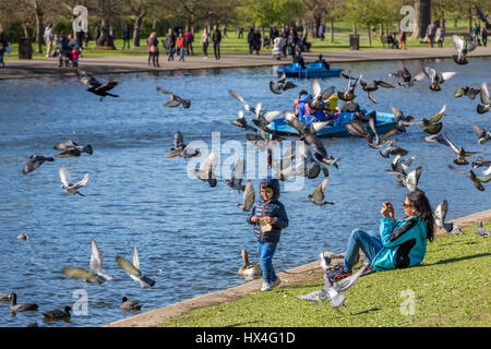 A beautiful sunny Saturday afternoon found Londoners and tourists alike enjoying the warm sunshine in The Regents - Stock Photo