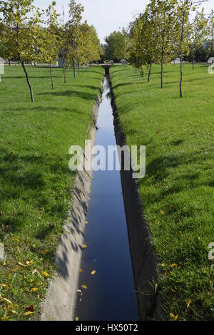 Drain drain for water. Autumn in the park. Park in a small village. Autumn colors. - Stock Photo