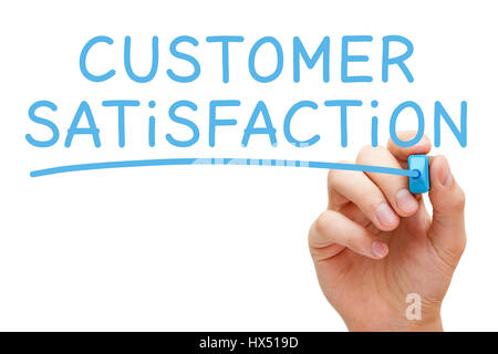 Hand writing Customer Satisfaction with blue marker on transparent glass board. - Stock Photo