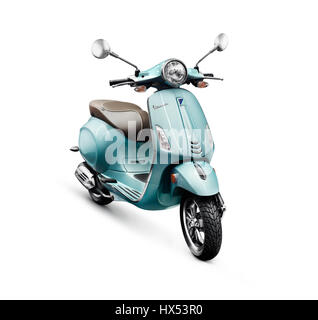 Blue 2017 motor scooter Vespa manufactured by Piaggio isolated on white background with clipping path - Stock Photo