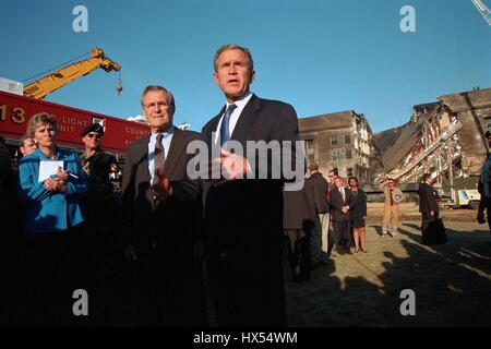 United States President George W. Bush (center front) gives an address in front of the damaged Pentagon following - Stock Photo
