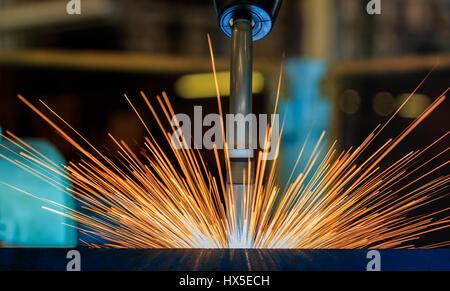 close up robot welding automotive part - Stock Photo