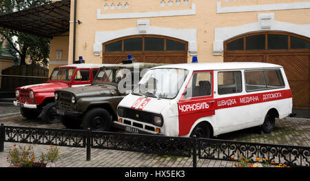 KIEV, UKRAINE - SEP 21, 2013: Museum of the History of Chernobyl - ambulance, fire service and the police - Stock Photo