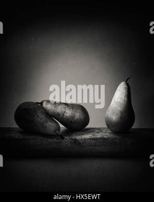 Three Pears on Driftwood - Stock Photo