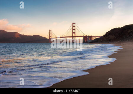 San Francisco beach and Golden Gate Bridge at sunrise, California. - Stock Photo