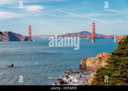 San Francisco beach and Golden Gate Bridge at sunrise, California. - Stock Photo