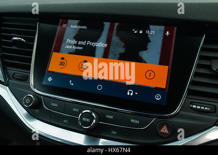 Android Auto Car Vehicle Navigation Interface With Audio Books - Stock Photo