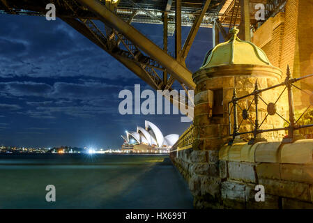 Sydney Opera House at dawn viewed from under the Sydney Harbor Bridge - Stock Photo