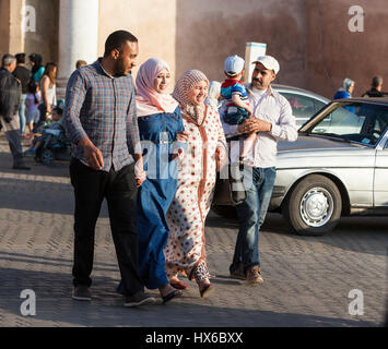 Meknes, Morocco.  Two Couples Crossing the Street at the Bab Mansour.  Women in Contemporary Conservative Dress, - Stock Photo