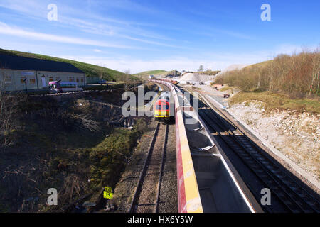 Freight train and railway tracks on British countryside in Peak District National Park,Derbyshire,United Kingdom.