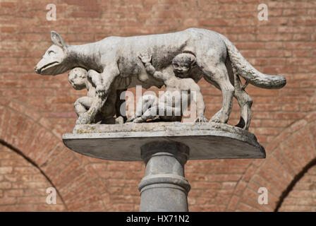 She-wolf with Romulus and Remus in front of the Duomo of Siena, Tuscany, Italy - Stock Photo