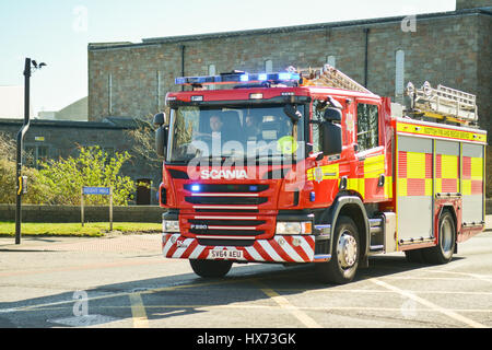 Fire Engine with  blue flashing lights responding to call in Aberdeen, Scotland, UK - Stock Photo
