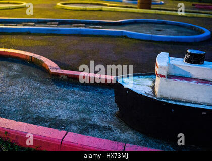 boat model in camden council estate crazy golf playground - Stock Photo