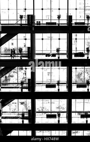Interior of the building with the glass curtain wall - Stock Photo