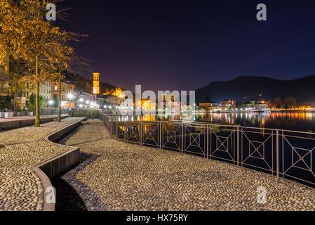 Lake Lugano, Porto Ceresio, north Italy. Night view of the beautiful lakeside promenade of Porto Ceresio - Stock Photo