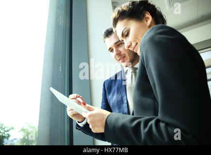 Young professionals work in modern office.Business crew working with startup. - Stock Photo