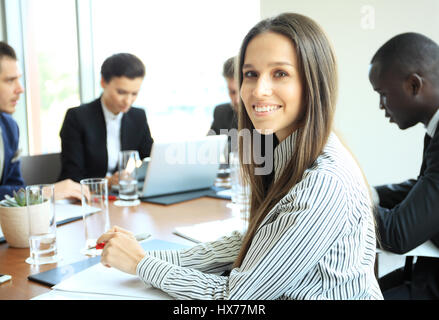 Modern business woman in the office - Stock Photo