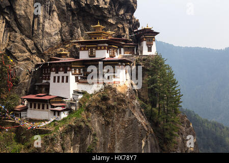 The Tiger's Nest Monastery, or Taktsang Goemba, is a Himalayan Bhuddist monastery perched on sheer cliffs 900 meters - Stock Photo
