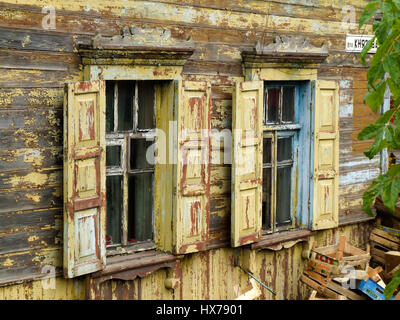 A traditional Russian house, made of wood or timbers and with nalichniki, fancy decorative wood trim, around the - Stock Photo