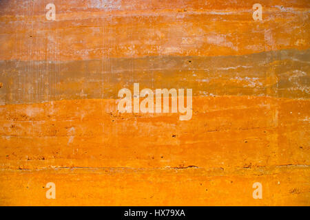 Grungy vintage orange polished concrete background texture - Stock Photo