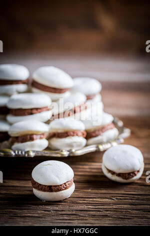 Macaroons with nut  and chocolate filling - Stock Photo