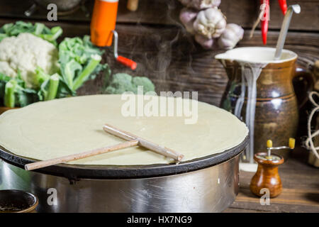 Homemade baking pancakes in the countryside on old wooden table - Stock Photo