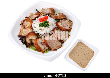 Beijing duck, Asian Cuisine, Chinese dish, Peking Duck, slices of of roast duck on a white plate, with rice noodles - Stock Photo