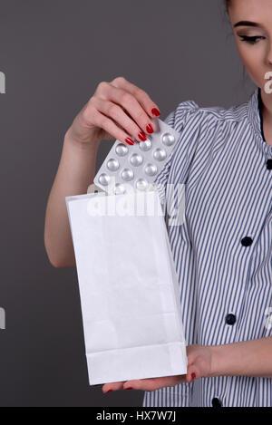 Nurse holding a blister pack of prescription drugs - Stock Photo