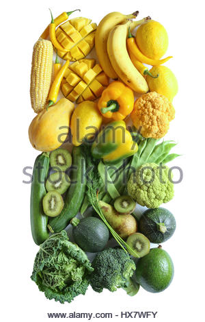 Gradient yellow and green fruit and vegetables on white background.Top view - Stock Photo