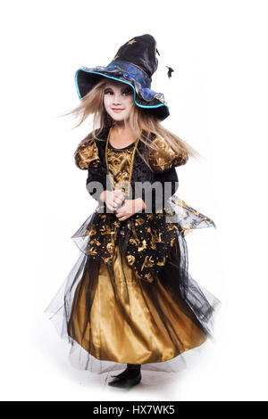 Adorable little blond girl wearing a witch costume smiling at the camera. Halloween. Fairy  sc 1 st  Alamy & Adorable little girl wearing witch costume casting a spell on Stock ...