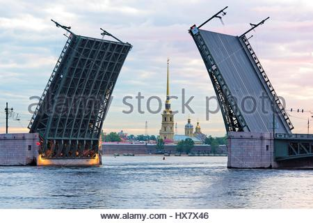 View of the Peter and Paul fortress and raised Palace bridge in summer white nights, St. Petersburg - Stock Photo