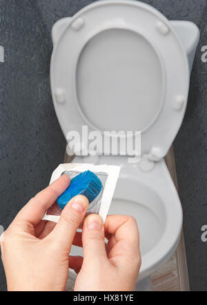Close Up Blue Cleaning Tablet For Sanitizing A Toilet