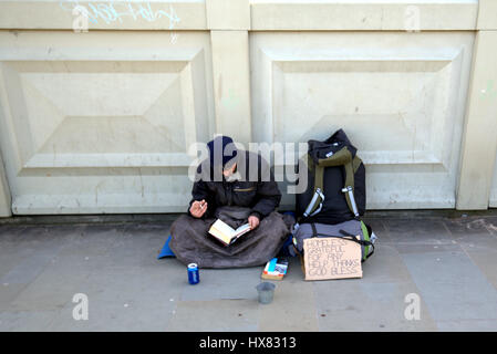 homeless in the uk begging on the street - Stock Photo