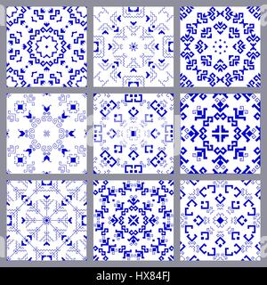 A set of blue geometric seamless patterns with traditional elements of the Chuvash culture on a white background. - Stock Photo