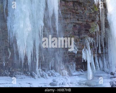 Frozen Muddy Creek waterfall Stock Photo