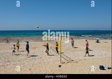 Tourists playing Volleyball on the Municipal Beach, Kato Paphos, Paphos, Cyprus. - Stock Photo