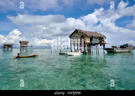 SEMPORNA SABAH, MALAYSIA - APRIL 19, 2015: Bajau Laut floating village built on a coral reef at sea in the vicinity - Stock Photo