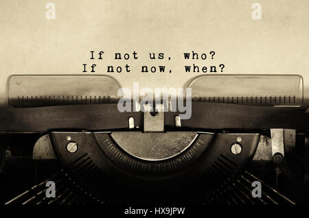 If not us, who? if not now, when? Inspirational quotes typed on vintage typewriter. - Stock Photo