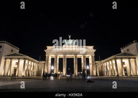 Berlin, Germany. 25th Mar, 2017. The Brandenburg Gate is lit up just before 'Earth Hour' in Berlin, Germany, 25 - Stock Photo
