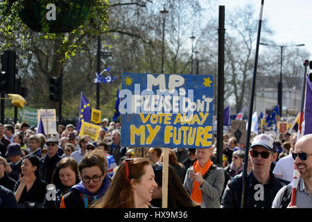 London, UK. 25th Mar 2017. A protester seen holding a placard reading: 'MPs Please Don't Vote Away My Future' during - Stock Photo