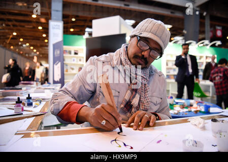 Paris, France. 25th Mar, 2017. A calligrapher from Saudi Arabia demonstrates Arabic calligraphy during the 37th - Stock Photo