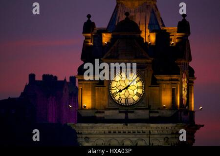Edinburgh, UK. 26th Mar, 2017. Sunset from Edinburgh's Calton Hill. The clock of the Balmoral Hotel is in the foreground - Stock Photo