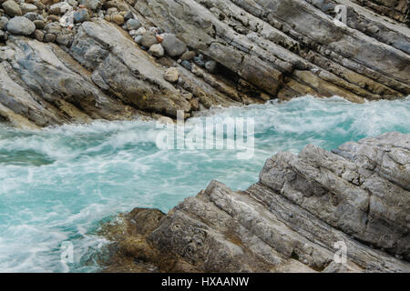 Very particular river rocks carved by turques water, in the mountain - Stock Photo
