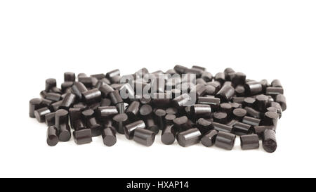black pieces liquorice candy on white background - Stock Photo