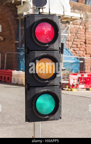 Confusing set of traffic lights showing red amber and green all at the same time can be used for concepts showing - Stock Photo