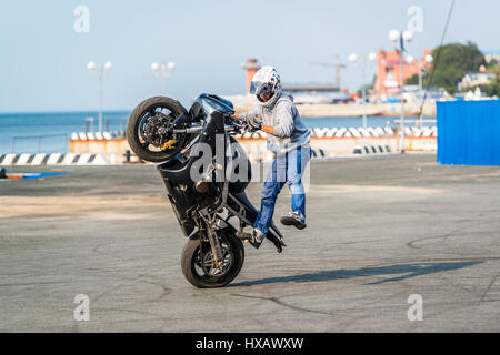 VLADIVOSTOK, RUSSIA - October 05, 2013: Stunt motorcycle rider performing at a local motorcycle show. - Stock Photo
